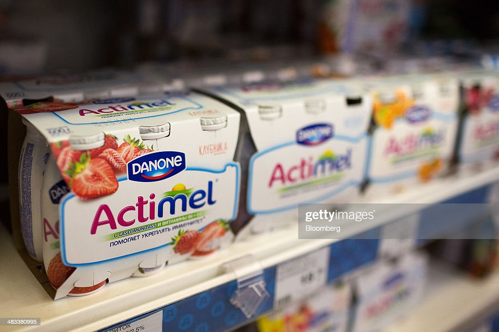 Actimel probiotic drinks produced by Danone SA sit on a shelf inside a Dixy supermarket operated by OAO Dixy Group in Moscow, Russia, on Tuesday, April 8, 2014. Suppliers suffering from ruble depreciation this quarter are urging retailers to increase prices. Photographer: Andrey Rudakov/Bloomberg via Getty Images