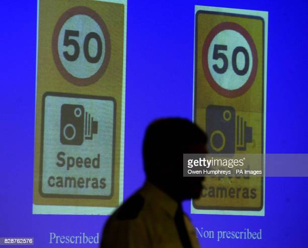 Acting Assistant Chief Constable of Cleveland Police John Burke at a news conference in Middlesbrough with the two different speed camera signs...