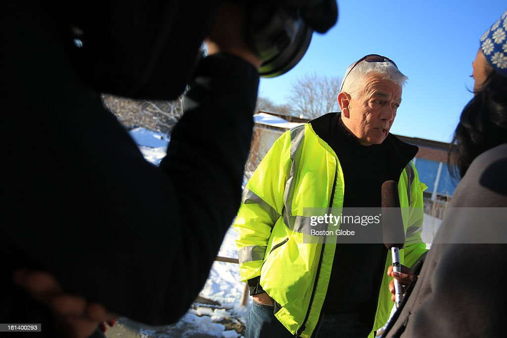 Acting Assistant Town Manager Albert Bangert talks with media after a Scituate town meeting with other town officials to discuss the town's response to the blizzard, Feb. 10, 2013.