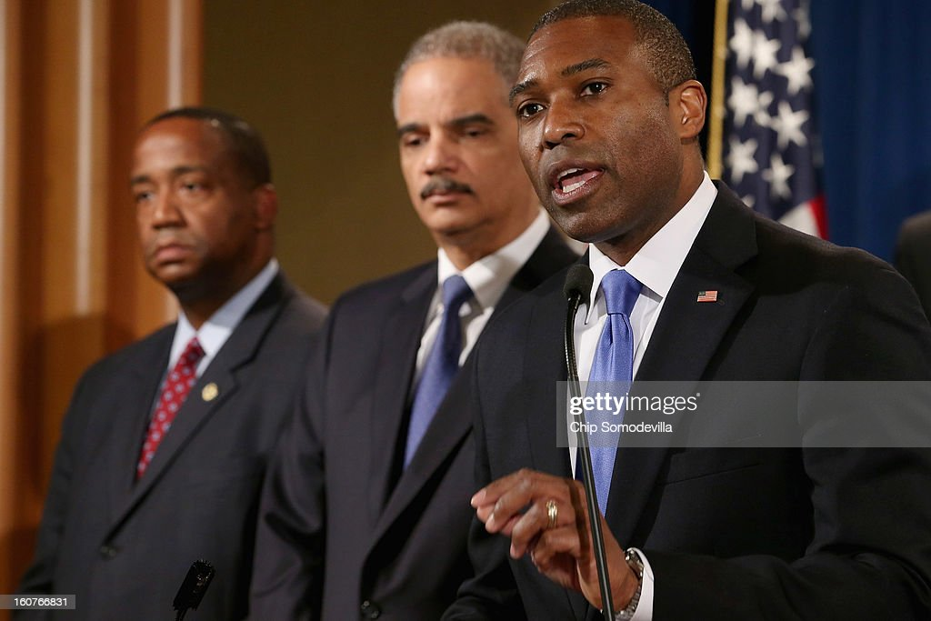 U.S. Acting Associate Attorney General Tony West (R) answers reporters' questions during a news conference with Attorney General <a gi-track='captionPersonalityLinkClicked' href=/galleries/search?phrase=Eric+Holder&family=editorial&specificpeople=1060367 ng-click='$event.stopPropagation()'>Eric Holder</a> (C), U.S. Attorney for the Central District of California Andre Birotte Jr. and attorneys general from eight states and the District of Columbia at the Department of Justice February 5, 2013 in Washington, DC. Holder announced that the United States is bringing a civil lawsuit against the ratings agency Standards & Poor's and its parent company, McGraw-Hill Companies, over its pre-fiscal crisis bond ratings.