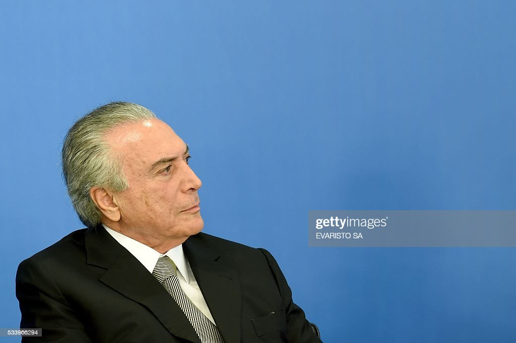 Acting Brazilian President Michel Temer at the swearing-in ceremony for the new culture minister, Marcelo Calero, at the Planalto Palace, the seat of government in Brasilia, on May 24, 2016. / AFP / EVARISTO SA
