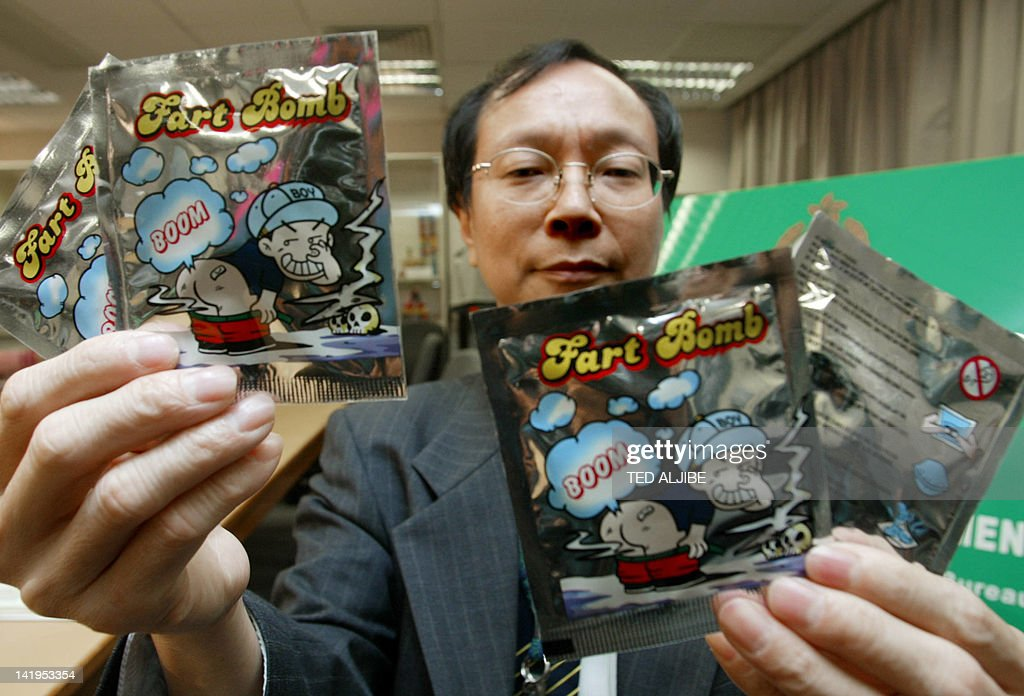 Acting chief trade control officer of the Customs and excise department Ng Hing Tong shows packets of fart bomb toy during a press conference in Hong...