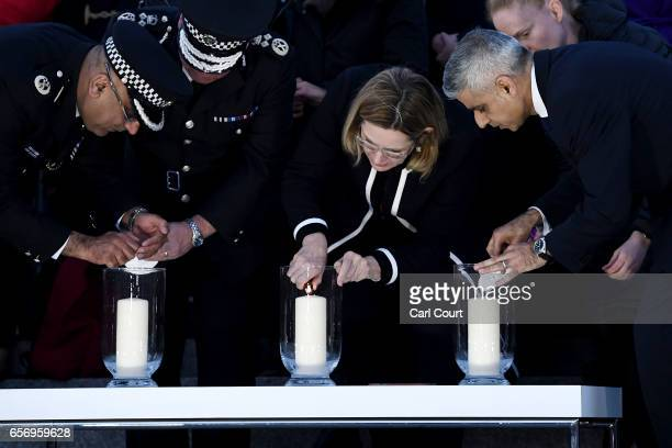 Acting Commissioner of the Metropolitan Police Craig Mackey Home Secretary Amber Rudd MP and Mayor of London Sadiq Khan light candles during a...