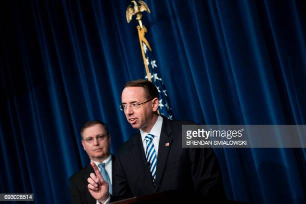 Acting DEA Administrator Chuck Rosenberg listens while Deputy Attorney General Rod Rosenstein speaks about fentanyl at the headquarters of the Drug...