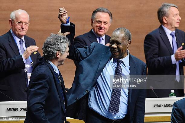 Acting FIFA president Issa Hayatou jokes with FIFA vice president Angel Maria Villar Llona during the extraordinary FIFA Congress in Zurich on...