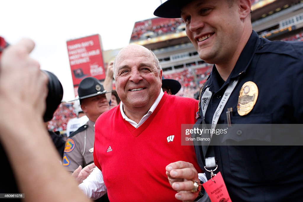 Acting head coach <a gi-track='captionPersonalityLinkClicked' href=/galleries/search?phrase=Barry+Alvarez&family=editorial&specificpeople=239480 ng-click='$event.stopPropagation()'>Barry Alvarez</a> of the Wisconsin Badgers smiles as he takes to the field following the Badger's 34-31 victory in overtime over the Auburn Tigers at the Outback Bowl on January 1, 2015 at Raymond James Stadium in Tampa, Florida.