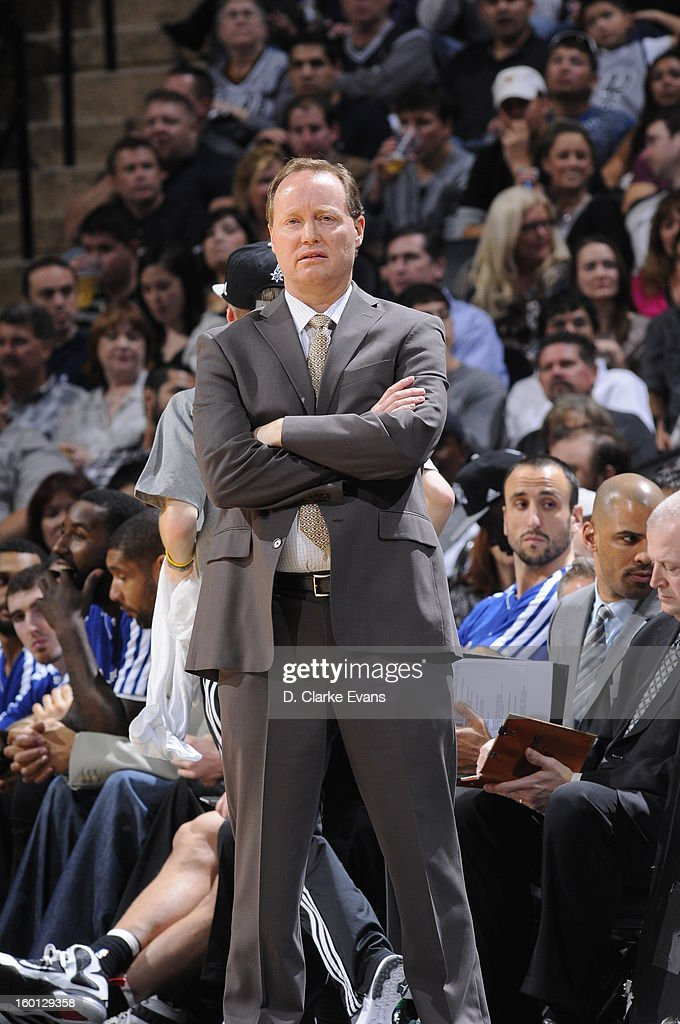 Acting Head Coach, Mike Budenholzer, of the San Antonio Spurs looks on from the sidelines during the game against the Phoenix Suns on January 26, 2013 at the AT&T Center in San Antonio, Texas.