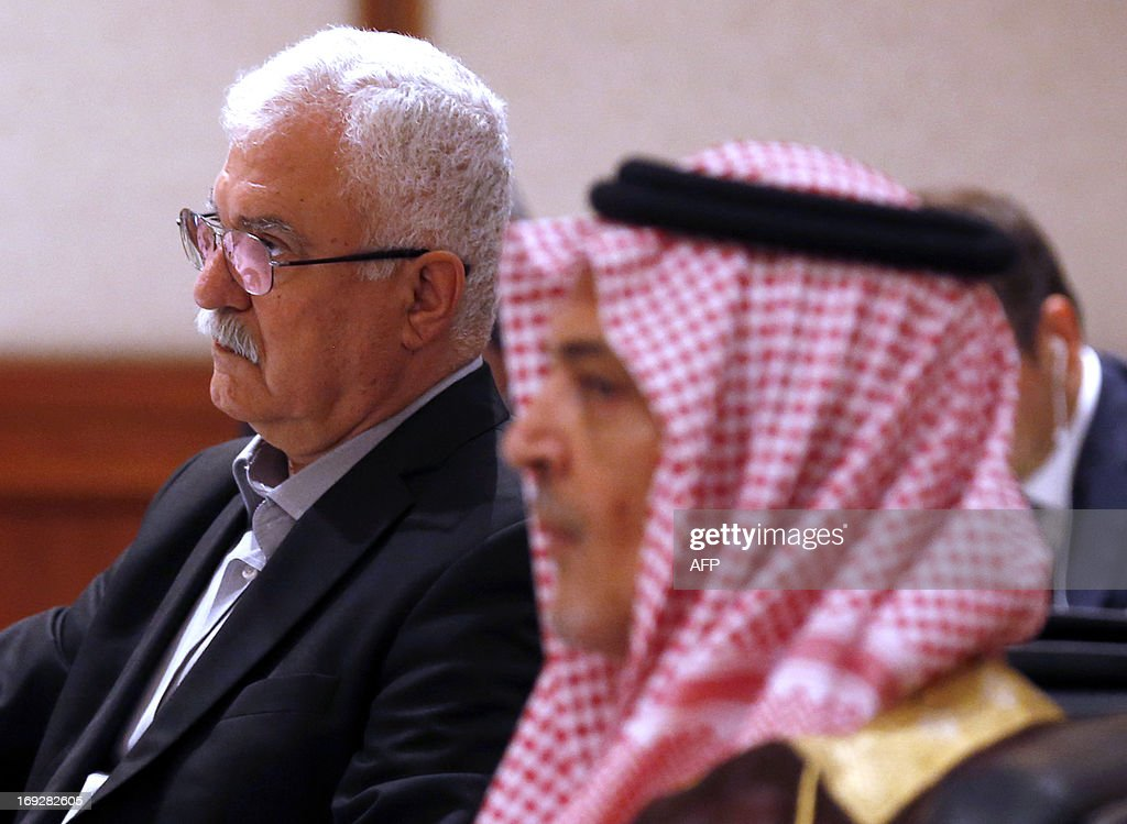 Acting head of the opposition Syrian National Coalition (SNC) George Sabra (L) listens during the 'Friends of Syria' meeting in Amman, Jordan on May 22, 2013. The gathering seeks to discuss US-Russian proposal to hold a peace conference dubbed 'Geneva 2' to bring together rebels and representatives of Syrian President's regime.