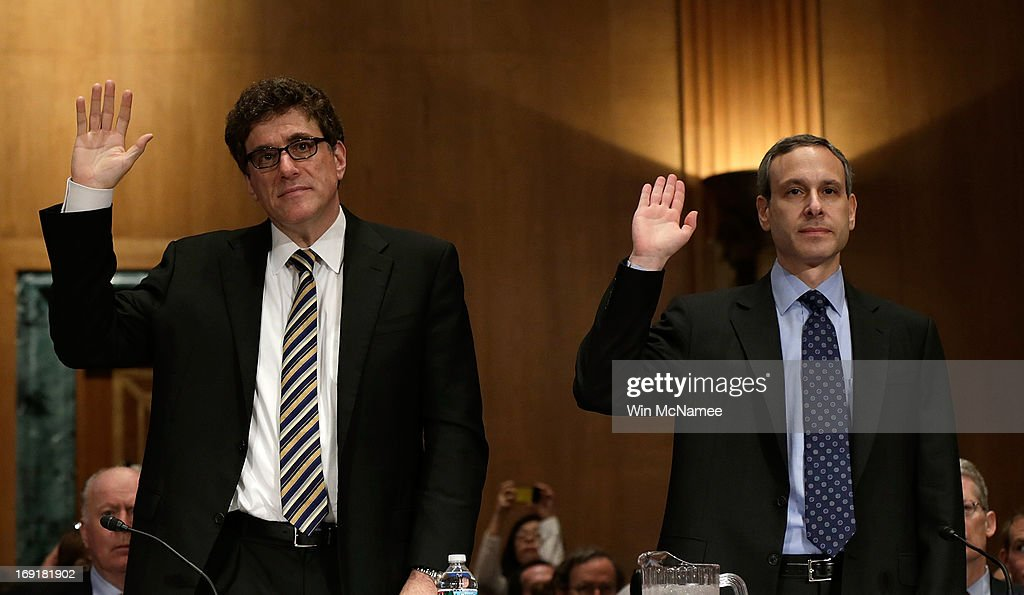 Acting IRS Commissioner Steven Miller and former IRS Commissioner Douglas Shulman are sworn in prior to testifying before the Senate Finance...