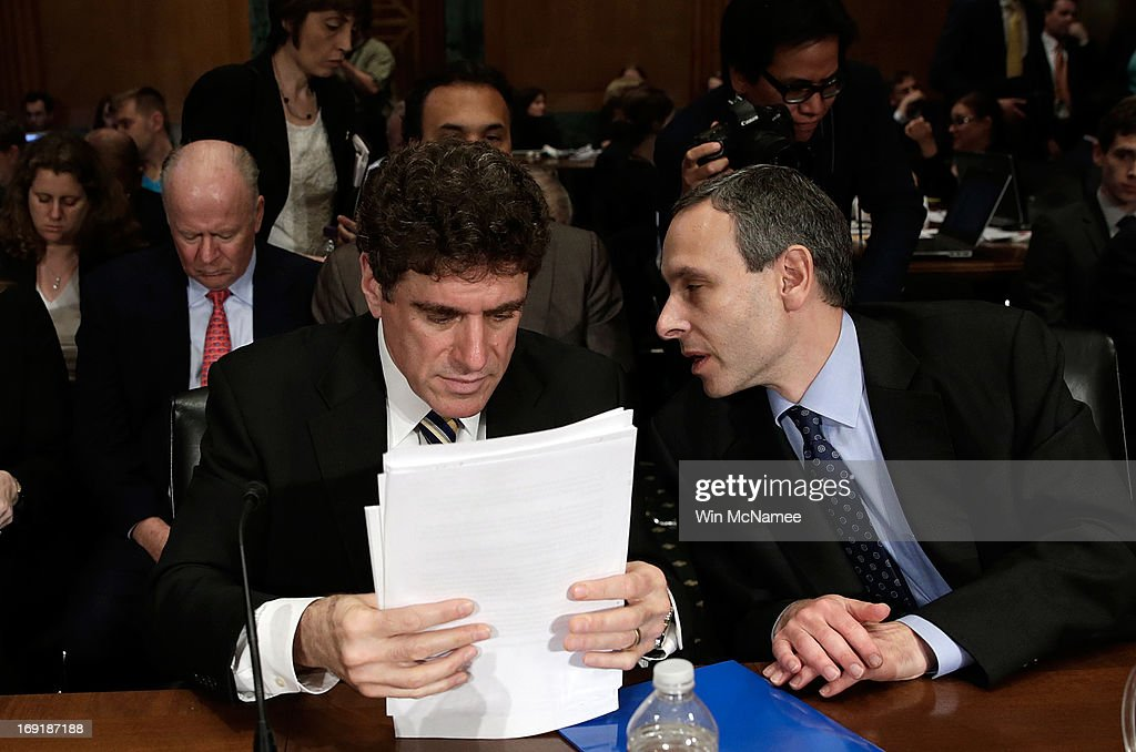 Acting IRS Commissioner Steven Miller and former IRS Commissioner Douglas Shulman confer during a break in testimony before the Senate Finance...