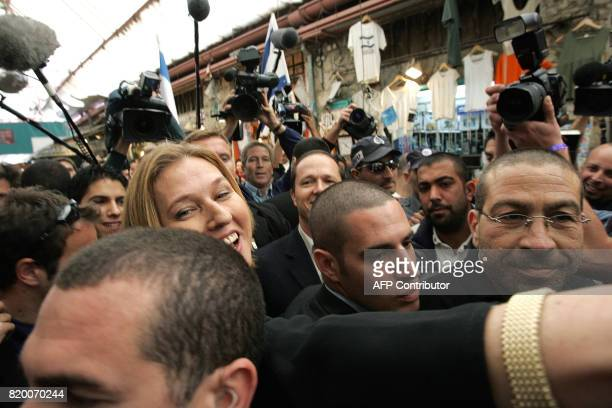 Acting Israeli Foreign Minister Tzipi Livni and second on the Kadima list greets people as she walks through a local market in Jerusalem 27 March...