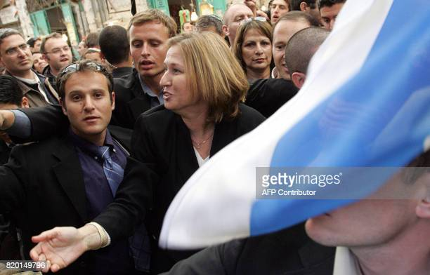 Acting Israeli Foreign Minister Tzipi Livni and second on the Kadima list visits a local market in Jerusalem 27 March 2006 as Israelis prepare to...
