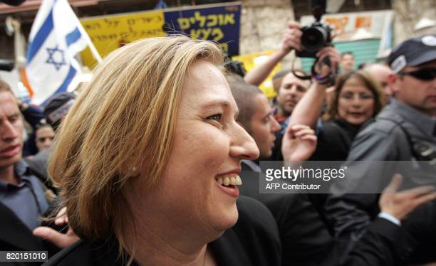 Acting Israeli Foreign Minister Tzipi Livni and second on the Kadima list walks through a local market in Jerusalem 27 March 2006 as Israelis prepare...