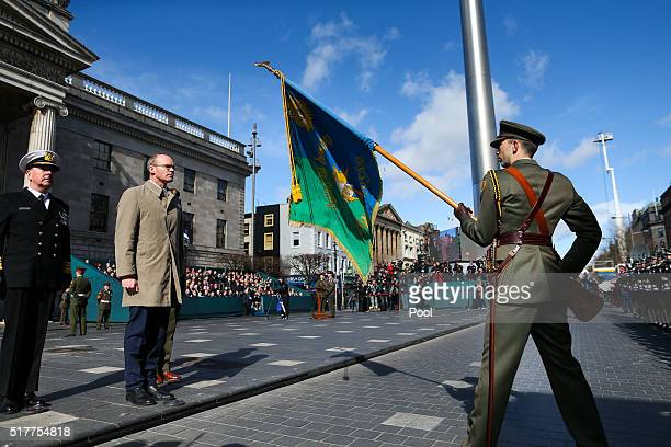 Acting Minister for Defence Simon Coveney and Members of the Defence Forces at the Easter Sunday Commemoration Ceremony at the General Post Office on...
