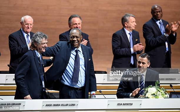 Acting President Issa Hayatou acknowledges applause from fellow delegates with FIFA Vice President Angel Maria Villar Llona and FIFA Acting Secretary...