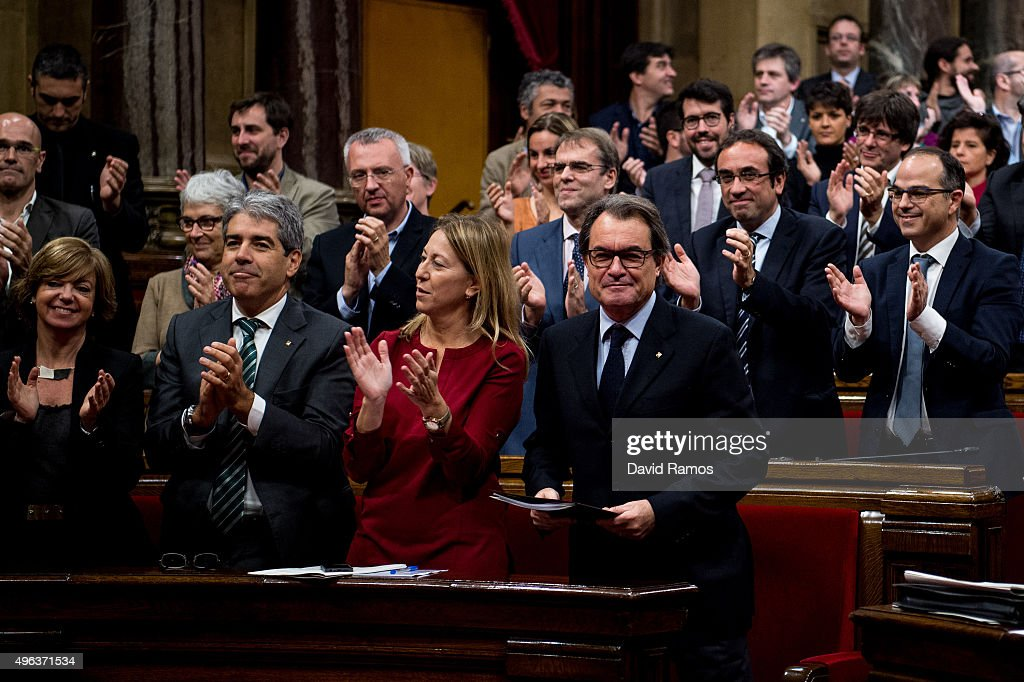 Acting President of Catalonia Artur Mas looks on as Junts Pel Si members of the Catalan parliament celebrate at the end of the parliamentary session...