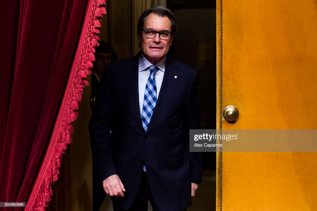 Acting President of Catalonia <a gi-track='captionPersonalityLinkClicked' href=/galleries/search?phrase=Artur+Mas&family=editorial&specificpeople=712829 ng-click='$event.stopPropagation()'>Artur Mas</a> walks through the Parliament during the parliamentary session debating on electing Carles Puigdemont as the new President of Catalonia on January 10, 2016 in Barcelona, Spain. After months of negotiations, the Catalanist coalition 'Junts pel Si' (Together for the Yes) and the Pro-Independence left-wing party 'Candidatura d'Unio Popular' CUP (Popular Unity Candidacy) have reached a last minute decision to promote the Mayor of Girona Carles Puigdemont to President of Catalonia. The coalition 'Junts pel Si' won the most of the seats in the regional elections held on September 27, 2015 but failed to form a Pro-Independence majority in the Parliament of Catalonia as CUP rejected Acting President of Catalonia and 'Junts pel Si' candidate <a gi-track='captionPersonalityLinkClicked' href=/galleries/search?phrase=Artur+Mas&family=editorial&specificpeople=712829 ng-click='$event.stopPropagation()'>Artur Mas</a> investiture.