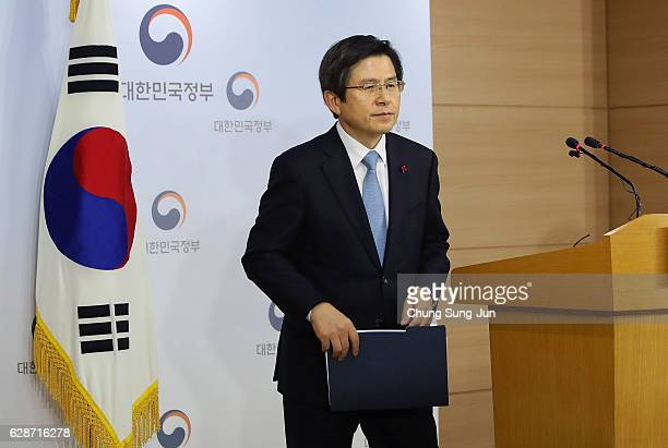 Acting President of South Korea Hwang KyoAhn leaves after the statement to the nation after parliament passed the impeachment motion against...