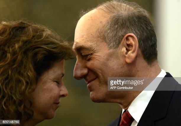 Acting Prime Minister Ehud Olmert stands with Dalia the daughter of the late Israeli Prime Minister Yitzhak Rabin assassinated in 1995 during a...