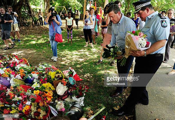 Acting Queensland Premier Tim Nicholls lays down a bunch of flowers at a memorial in a park next to the home of a multiple stabbing in the suburb of...