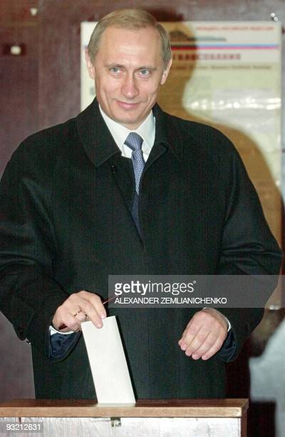 Acting Russian President and Presidential candidate Vladimir Putin smiles as casts his voting ballot at a polling station in Moscow 26 March 2000...
