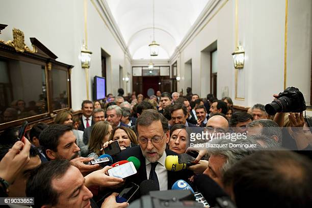Acting Spanish Prime Minister Mariano Rajoy speaks to the press after winning the investiture debate at the Spanish Parliament on October 29 2016 in...