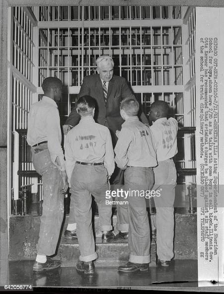 Acting superintendent of the Sheridan School for Boys shown here Feb 20th as he talks with some boys in cell block Illinois Gov Otto Kerner has...