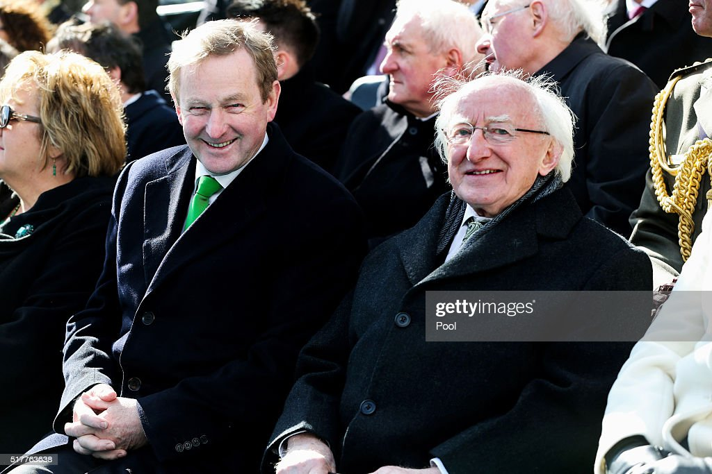 Acting Taoiseach <a gi-track='captionPersonalityLinkClicked' href=/galleries/search?phrase=Enda+Kenny&family=editorial&specificpeople=5129605 ng-click='$event.stopPropagation()'>Enda Kenny</a> chats to President <a gi-track='captionPersonalityLinkClicked' href=/galleries/search?phrase=Michael+D.+Higgins&family=editorial&specificpeople=7493414 ng-click='$event.stopPropagation()'>Michael D. Higgins</a> at the Easter Sunday Commemoration Ceremony and Parade from OConnell Street on March 27, 2016 in Dublin, Ireland. Today marks the 100th anniversary of the Easter Rising in the Republic of Ireland when in 1916 a rebellion was attempted to oust British rule of the country.