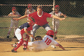 Action at home plate in boys baseball game