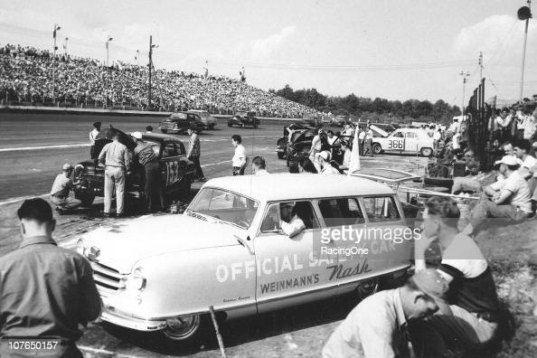 Action during a NASCAR Cup race as viewed from the pit area at Langhorne Speedway
