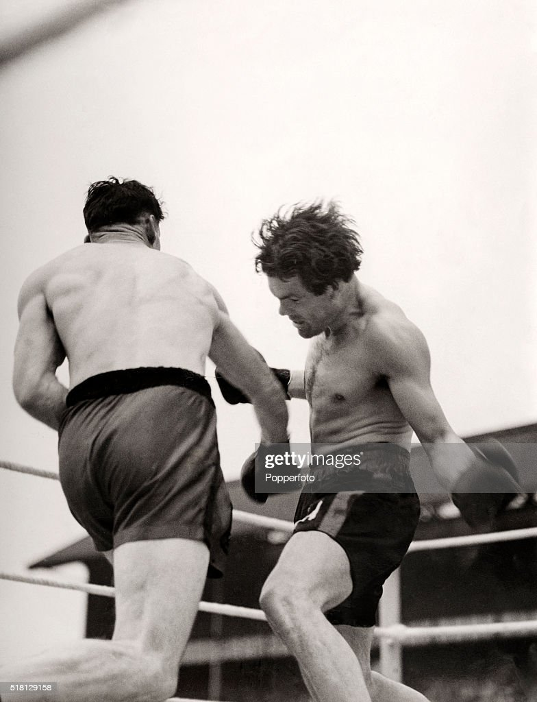 Action during the British and Empire light heavyweight title boxing match between Pilot Officer Len Harvey (left) and Sergeant Freddie Mills at White Hart Lane in Tottenham on 21st June 1942. Harvey was knocked out of the ring by Mills in the second round.