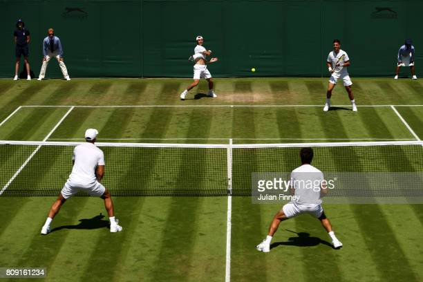 Action during the Gentlemen's Doubles first round match between JeanJulien Rojer of of the Netherlands and Horia Tecau against Thanasi Kokkinakis of...