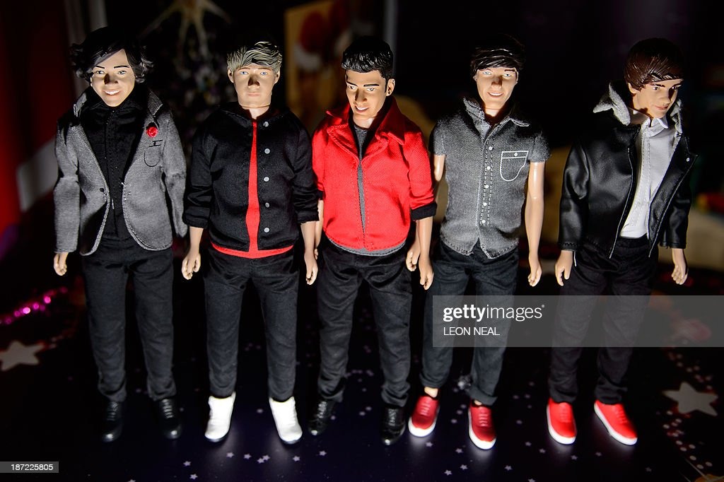 Action figures of the British pop band 'One Direction' are displayed at the Dream Toys 2013 top ten preview event in London on November 6, 2013. The event sees manufacturers of the predicted Christmas bestsellers showcase their products in the run up to the festive season.