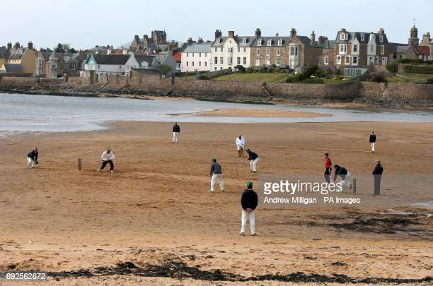 Action from the beach cricket match in Elie between the Ship Inn cricket team in Elie Fife and Eccentric Flamingos CC as the tide comes in The Ship...