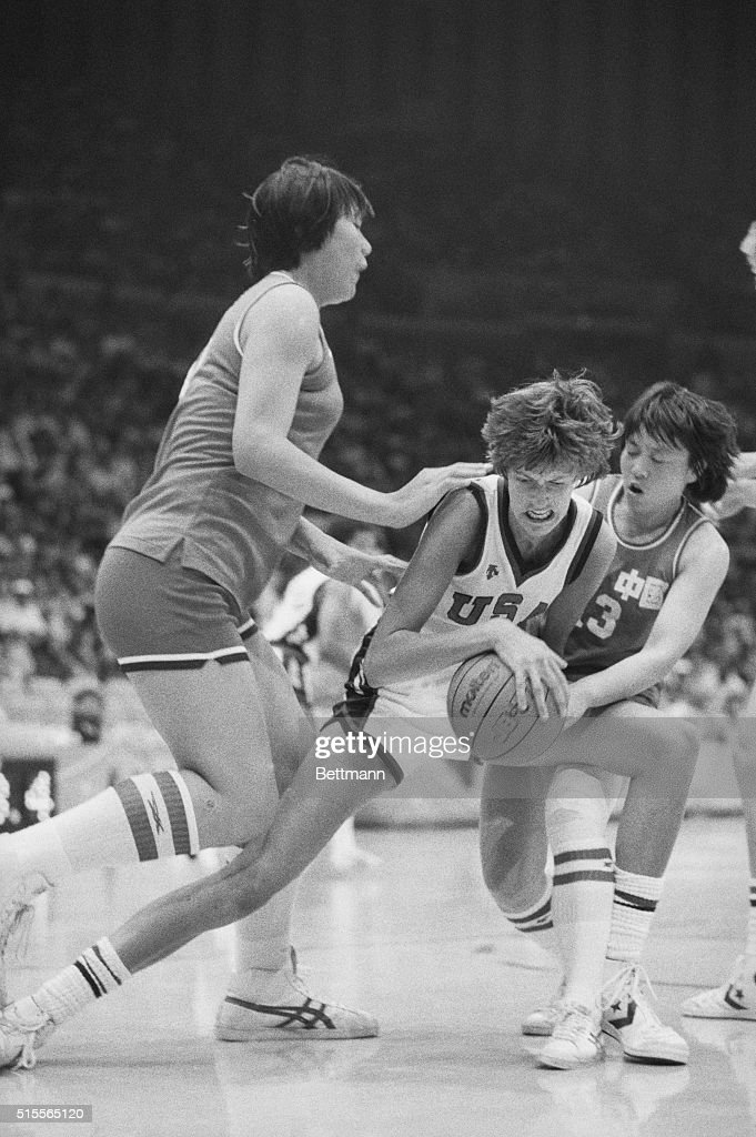Action in ChinaUSA Women's Preliminary Basketball event 8/3 in Los Angeles sees USA's Anne Donovan fighting for the ball with China's Hui Zhang USA...