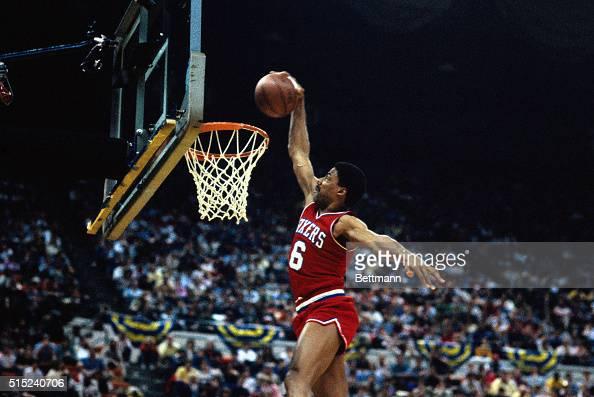 Action Philadelphia 76ers' Julius Erving making a basket during unidentified game
