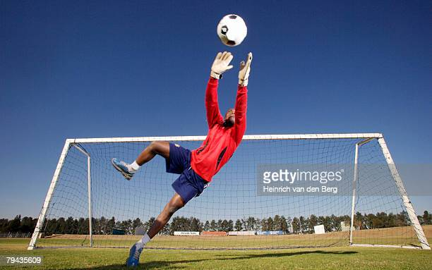Action shot of a goalie leaping in the air to catch a ball, Pretoria, Gauteng Province, South Africa