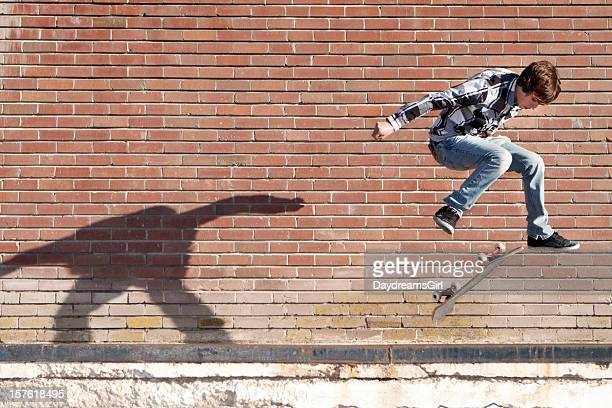 Action Shot of Teenage Male Skateboarder Jumping