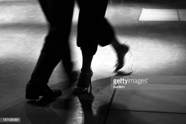 Action shot of the feet of a man and woman dancing