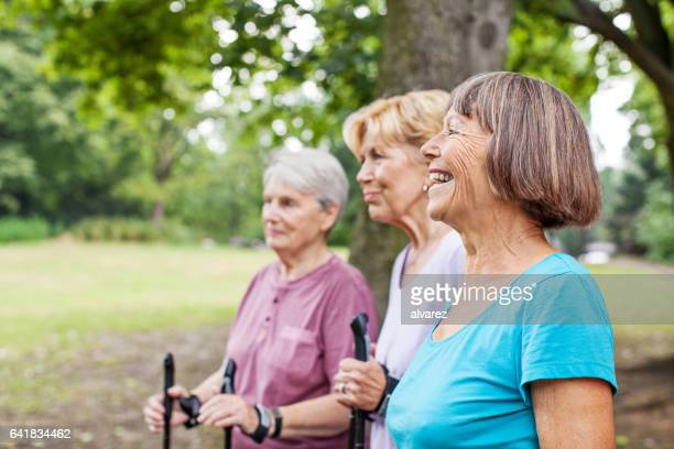 Active and healthy senior women walking in park
