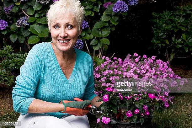 Active Beautiful Senior Woman Gardening, Copy Space