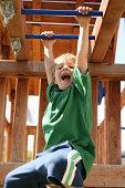 Active Boy On Monkey Bars