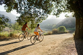 Active couple biking on scenic road.