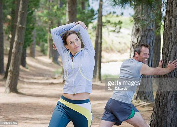 Active couple stretching in remote area
