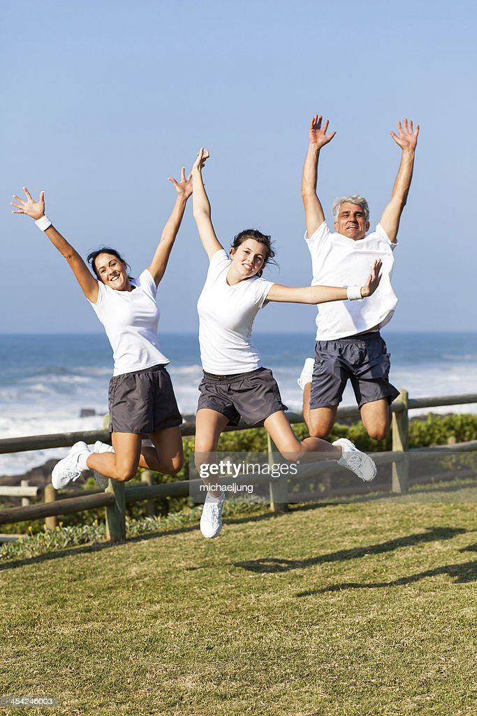 active family jumping : Stock Photo