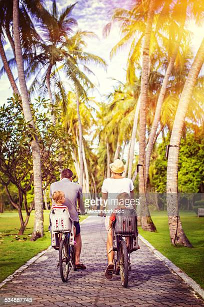 Active family on a vacation riding a bicycles