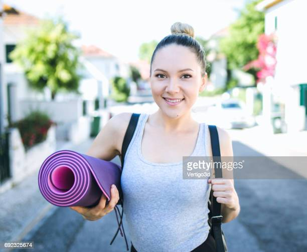 Active fitness woman in real life, make workout and yoga outdoors