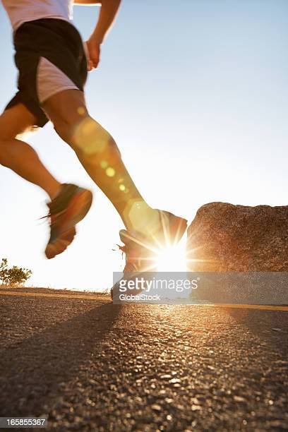 Active man running on country road