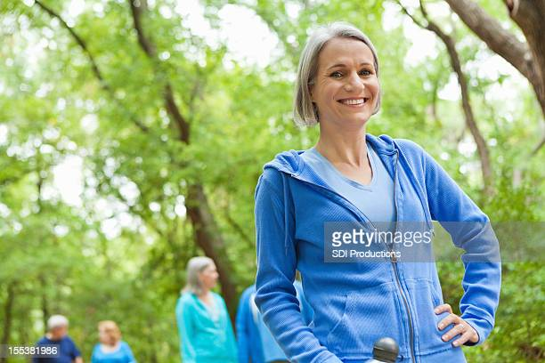Active mature woman exercising in park
