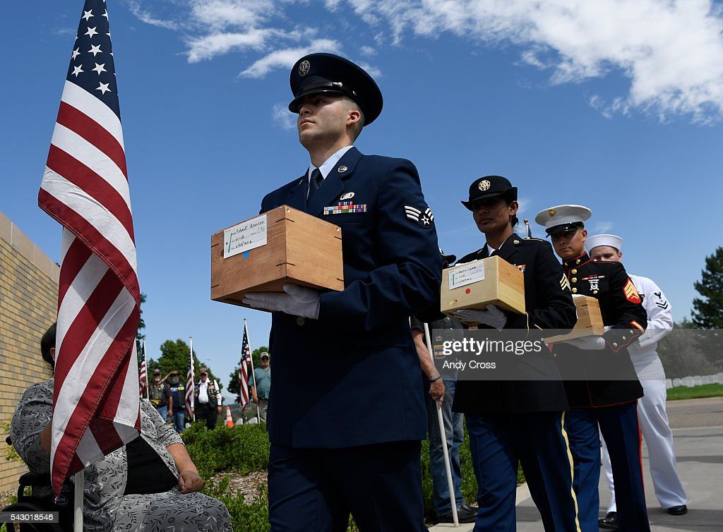 Active military members carry in the cremated remains of Veterans to be interned at a ceremony at Ft. Logan National Cemetery June 25, 2016. Missing in America Project interned the unclaimed remains of 30 WWII, Korea, and Vietnam Veterans at the Ft. Logan National Cemetery of June 25, 2016.